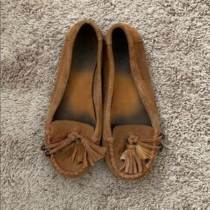 Minnetonka moccasins with feathers and tassels